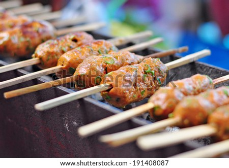 Grilled curried fish cake. (Tod Mun - Thai Food) - stock photo