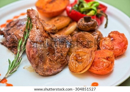 grilled duck legs with vegetables - stock photo