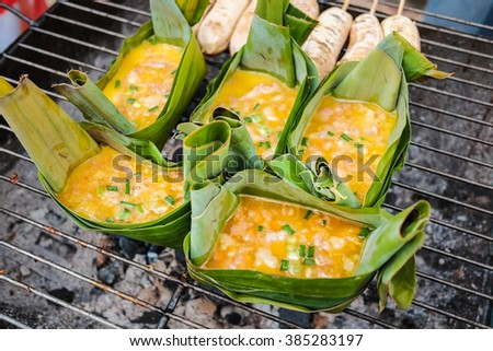 """Grilled egg in banana leaf cup called """" Khai Pam"""", the northern traditional food of Thailand , . - stock photo"""
