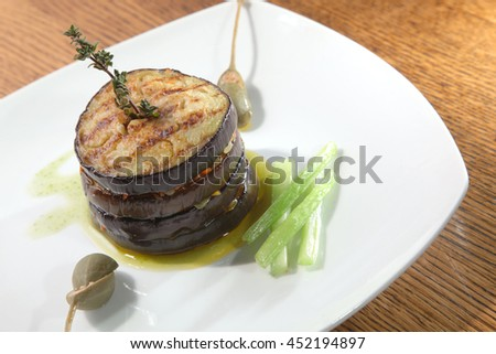 Grilled Eggplant on white plate - stock photo
