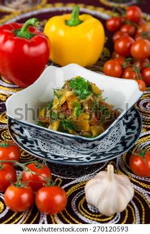 Grilled eggplant, peppers, tomatoes and onions with herbs - stock photo