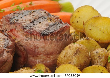 Grilled filet mignon, potatoes and carrots closeup. - stock photo