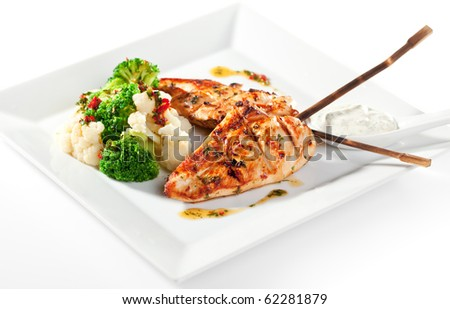 Grilled FIllet of Chicken Garnished with Cauiliflower - stock photo