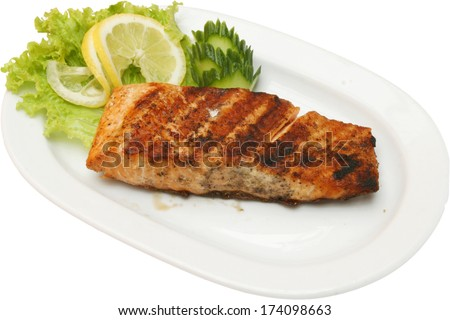 Grilled fish fillet on barbecue with vegetables - stock photo