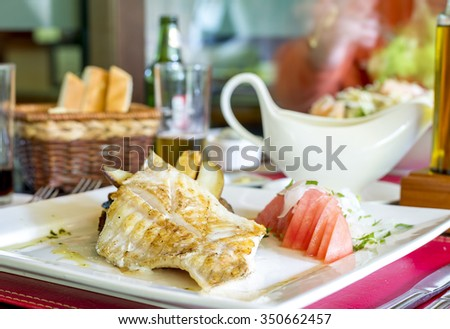 grilled fish fillet with vegetables, fish dish, fish meal, fish dinner, fish plate, chile food, south america food, diet food - stock photo