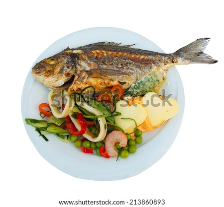 Grilled fish on white plate with herbs cheese and shrimp isolated over white background, top view. Mediterranean luxurious seafood concept.  - stock photo
