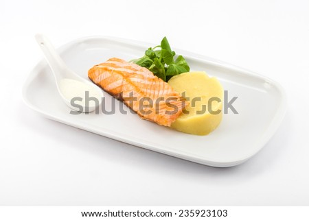 Grilled fish with mashed potatoes for garnish - stock photo