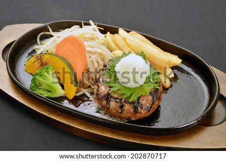 Grilled Foods -Hamburger with teriyaki sauce with Vegetables,Japanese style - stock photo