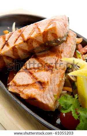 Grilled Foods - Salmon Steak with Vegetables. Garnished with Lemon and Parsley - stock photo