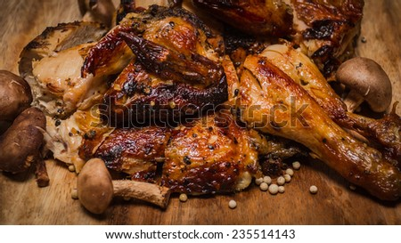 grilled healthy chicken cooked on a summer fresh herbs on a wooden board, close up view - stock photo