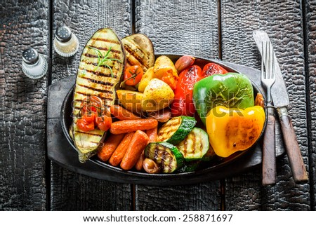 Grilled healthy vegetables on barbecue dish - stock photo