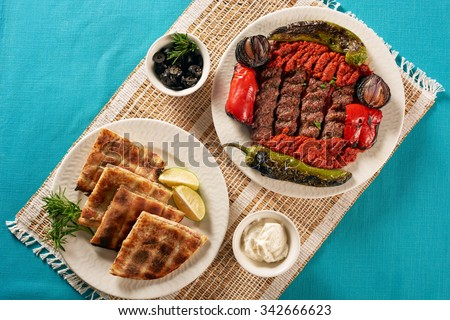 Grilled Kabab and Arabic bread filled with meat - stock photo
