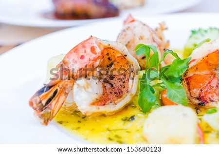 Grilled king prawns pernod served with dill potatoes - stock photo