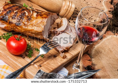 Grilled lamb on wooden board with red wine - stock photo