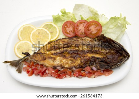 Grilled Mackerel fish with lime and salad - stock photo