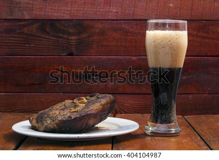grilled meat and mug of beer  - stock photo