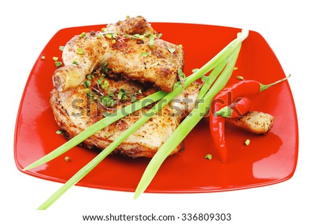 grilled meat : chicken quarters garnished with green sprouts and red peppers on red plate isolated over white background - stock photo