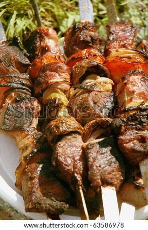 Grilled meat on a skewer. Close up. - stock photo