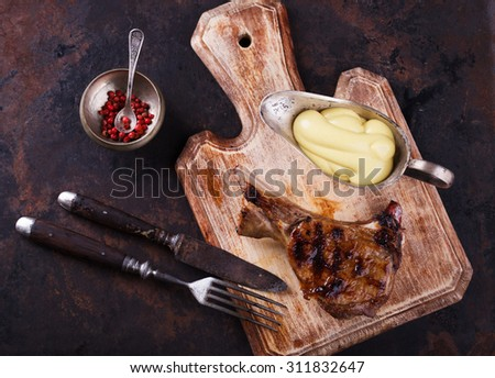 Grilled meat on the bone with mustard sauce.selective focus - stock photo