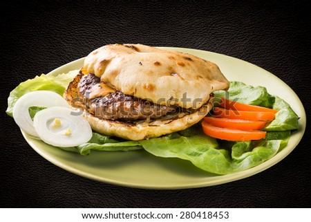 Grilled meat patty with cheese - stock photo