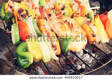 Grilled meat, shrimps and vegetables, barbecue grill food - stock photo