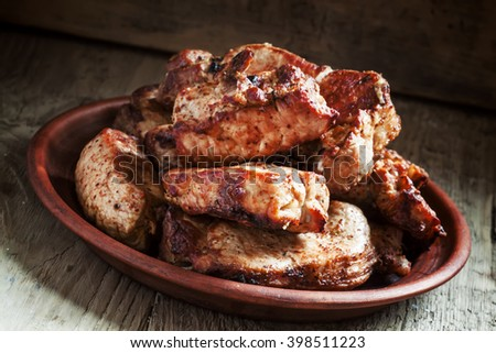Grilled meats, hot pieces on a clay dish, selective focus - stock photo