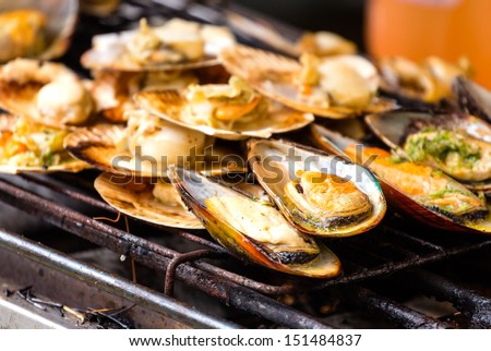 Grilled mussels on the grate - stock photo