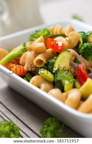 grilled noodles with fresh vegetables and vegan soy cream sauce - stock photo
