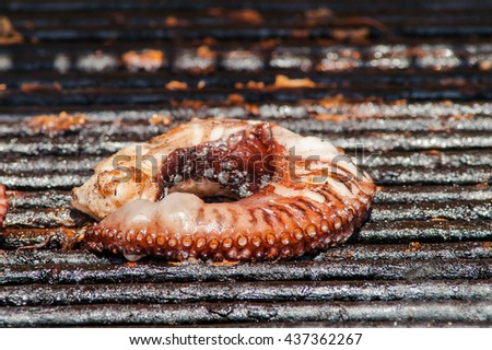 grilled octopus on the grill close up - stock photo