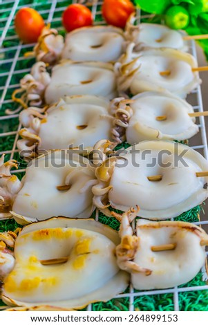Grilled octopus skewers - stock photo