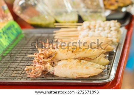 Grilled octopus skewers in Thailand market - stock photo