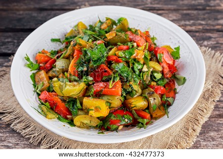 Grilled paprika salad with fresh parsley and basil - stock photo