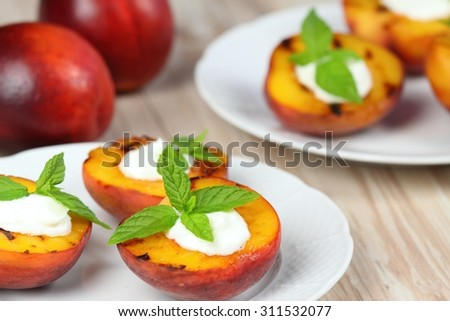 Grilled peaches and mascarpone with mint  leaves - stock photo