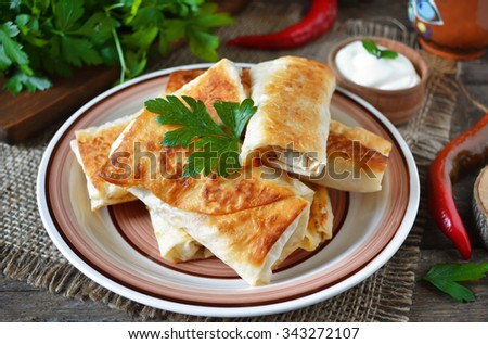 Grilled pita bread with cheese filling  - stock photo