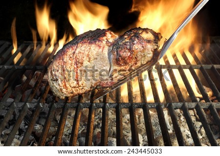 Grilled Pork Chop on the Hot BBQ Grill - stock photo