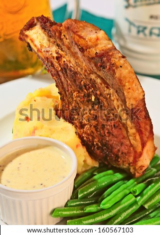 grilled pork chops with green beans and potato mash - stock photo