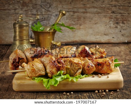 grilled pork meat kebab on wooden skewers - stock photo