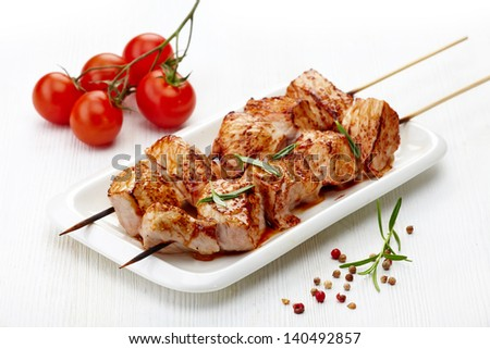 grilled pork meat  on white plate, pork barbecue - stock photo
