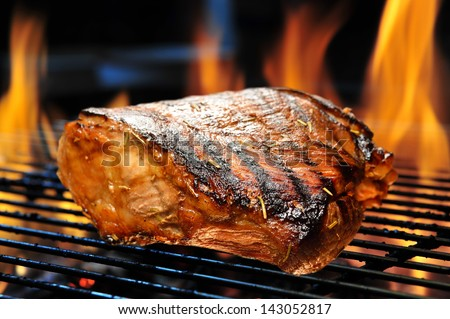 Grilled pork on the grill. - stock photo