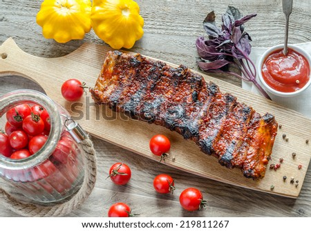 Grilled pork ribs in barbecue sauce - stock photo