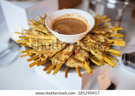 Grilled pork served with peanut sauce or sweet and sour sauce( moo satay) - stock photo