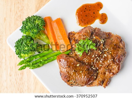 Grilled pork steak with vegetable on a plate, BBQ Steak, Healthy Food. - stock photo