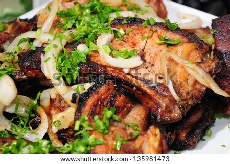 Grilled pork with spicy salad - stock photo