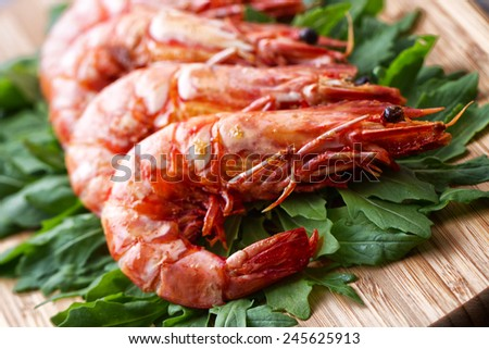 Grilled prawns with rocket salad - stock photo