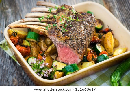 Grilled Rack of Lamb chops with potatoes an vegetables   - stock photo