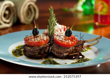 Grilled Rack of Lamb with Tomatoes and Pesto - stock photo