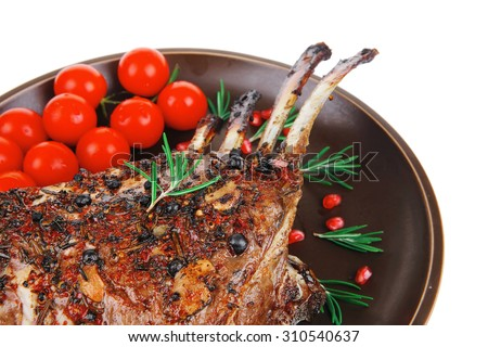 grilled ribs with cherry on dark plate - stock photo