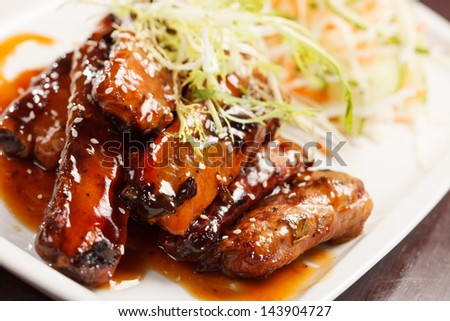 grilled ribs with salad - stock photo