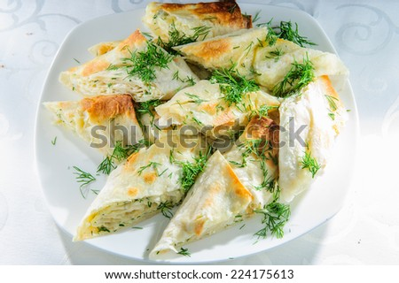 Grilled rolls of bread lavash with cheese inside. - stock photo