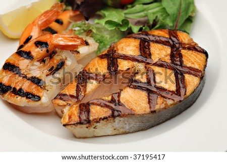 Grilled salmon an shrimps - stock photo